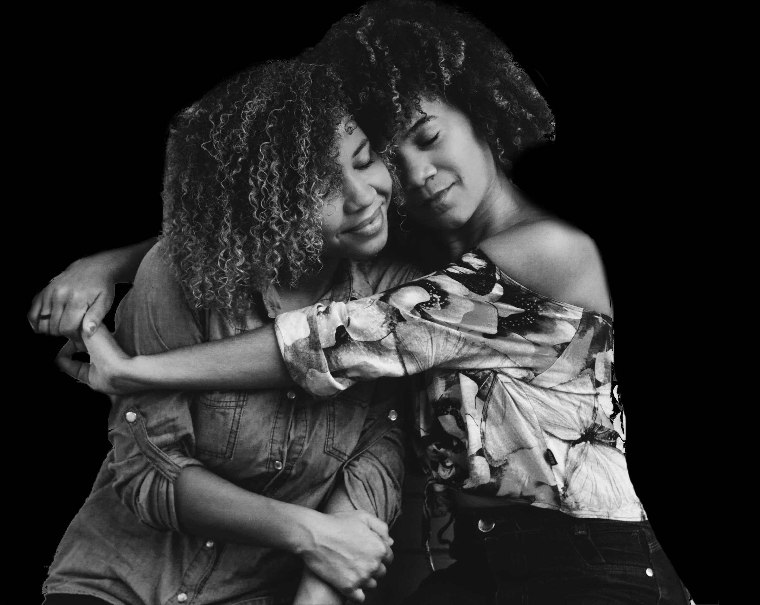 two Black girls embracing