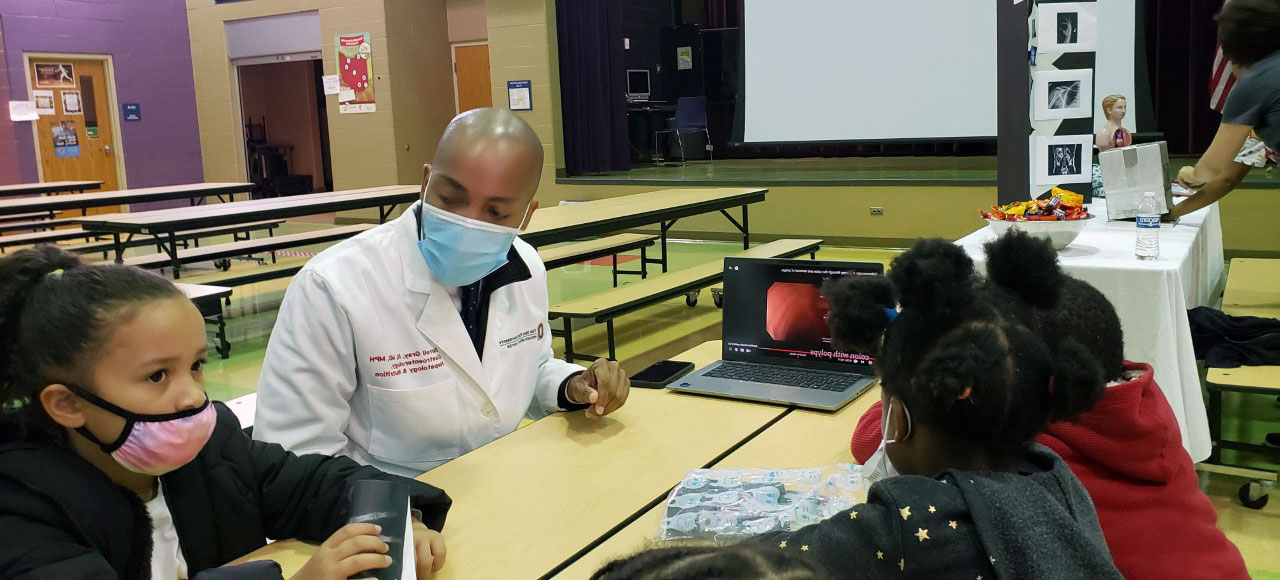 photo of healthcare professional with children at a table