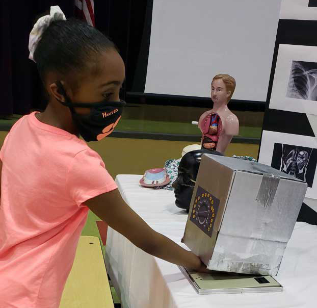 child interacting with display